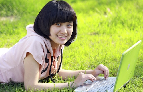 female teen with computer